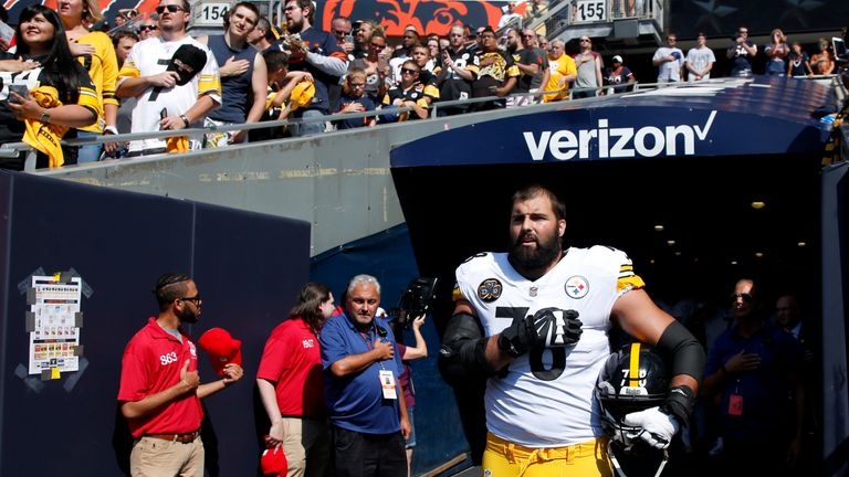Alejandro Villanueva of the Pittsburgh Steelers stands by himself in the tunnel for the national anthem