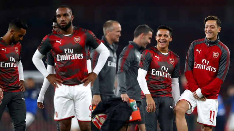 Cech believes Alexis Sanchez (left) and Mesut Ozil remain committed to Arsenal