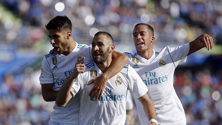 Karim Benzema celebrates after putting his side in the lead