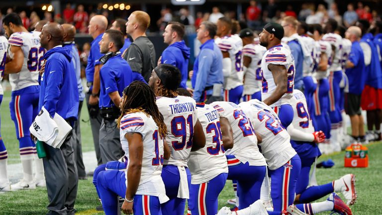 Buffalo Bills players kneel during the national anthem prior to their game against the Atlanta Falcons