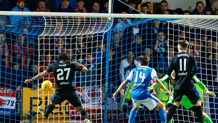 Carlos Pena (left) stretches to open the scoring at McDiarmid Park