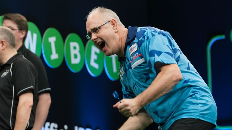 Ian White celebrates during his thrilling 6-5 victory over Darren Webster (Picture: Kelly Deckers)