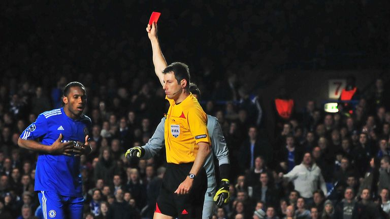Didier Drogba is shown a red card after a clash with Thiago Motta in the return leg