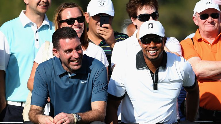 Tiger Woods with his agent Mark Steinberg (left)