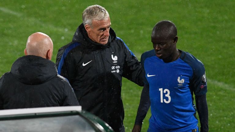 N'Golo Kante is comforted by France's coach Didier Deschamps after limping off for France