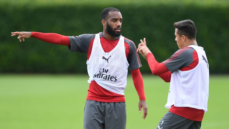 Alexandre Lacazette and Alexis Sanchez work on their partnership on the training ground