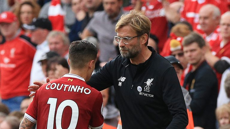 Liverpool manager Jurgen Klopp hugs Philippe Coutinho as he is substituted against Manchester United