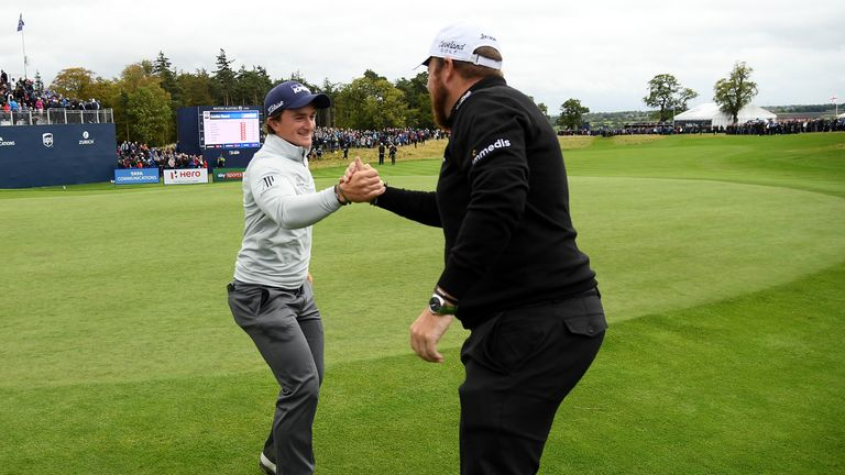 Dunne congratulated by Irish compatriot Shane Lowry after earning his maiden European Tour win