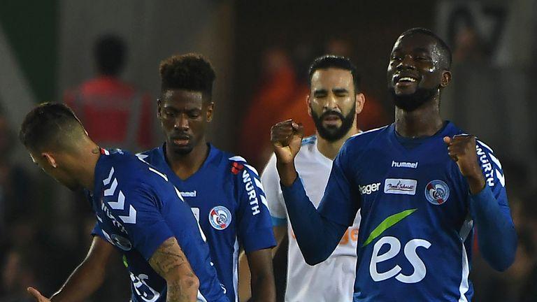 Jean-Eudes Aholou (R) celebrates after scoring for Strasbourg