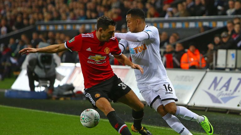 Matteo Darmian vies with Swansea defender Martin Olsson