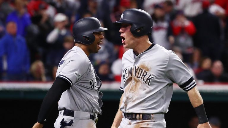 Todd Frazier (right) and Aaron Hicks celebrate during the Yankees game five victory