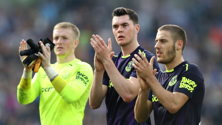 Nikola Vlasic, Michael Keane and Jordan Pickford applaud the crowd after the draw with Brighton