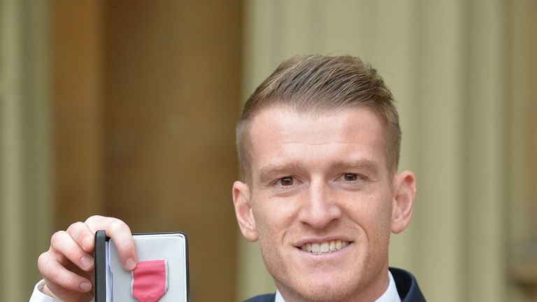 Steven Davis holds the MBE presented to him by the Duke of Cambridge at the Investiture ceremony