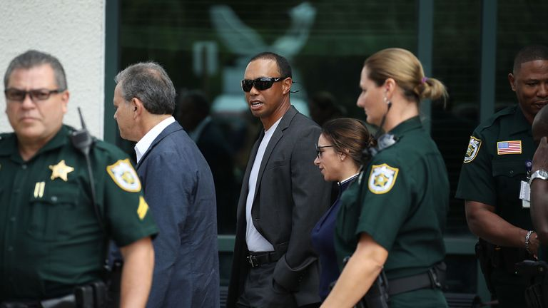 Tiger Woods leaves the North County Courthouse after pleading guilty to a charge of reckless driving