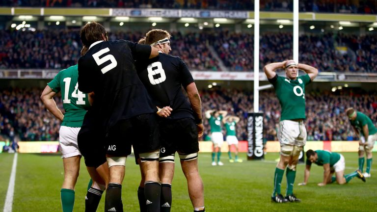 The All Blacks celebrate Ryan Crotty's last-gasp try in 2013