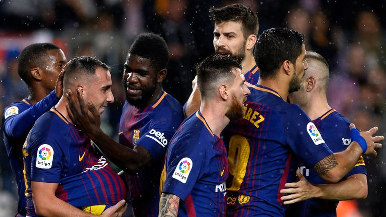 Paco Alcacer (2nd-L) celebrates with team-mates after giving Barcelona the lead