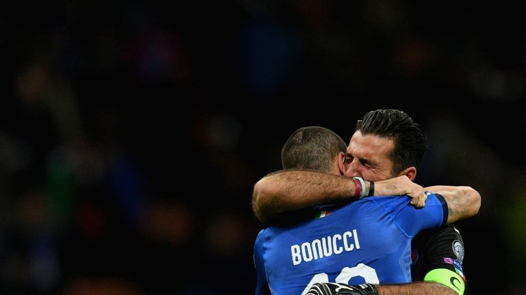 Leonardo Bonucci and Buffon console each other after Italy's exit