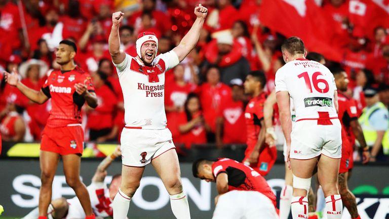 Chris Hill of England celebrates beating Tonga