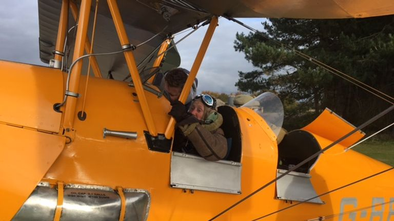Eileen buckles up in the Tiger Moth ahead of take off