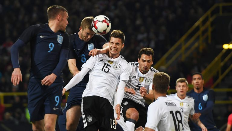 Man City are eyeing a move for Julian Weigl (centre)
