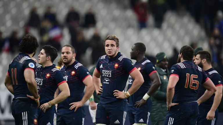 France's players react after defeat in the Test match against South Africa's at the Stade de France