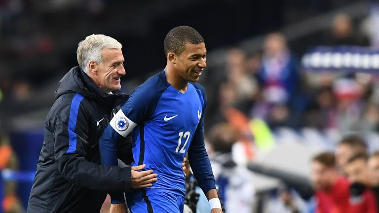 France coach Didier Deschamps congratulates Mbappe on his display