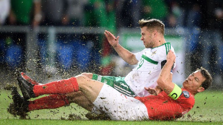 Northern Ireland's Jamie Ward (left) vies with Stephan Lichtsteiner during the second leg in Basel