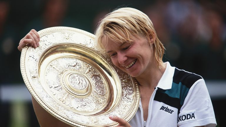 Novotna holds her winners trophy during the 1998 Wimbledon Championships