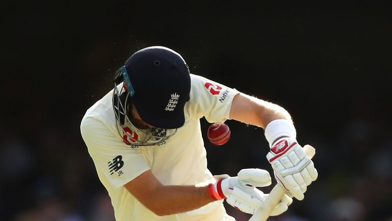 Root is struck in the helmet by a delivery from Starc