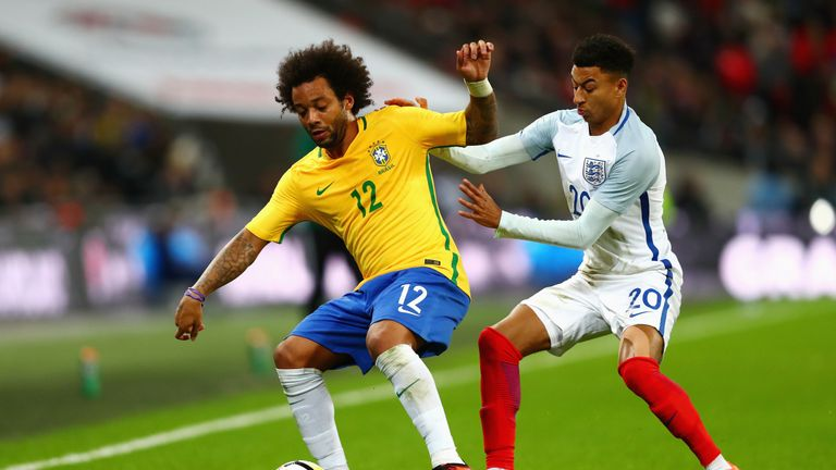Jesse Lingard and Marcelo fight for the ball at Wembley