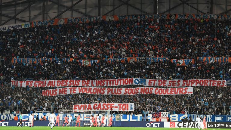 Olympique de Marseille fans hold a banner aimed at Evra, reading: 'You thought you were above the institution OM and its supporters. We don't want you wearing our colours'