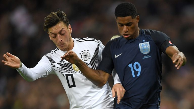 Rashford tussles with Germany's Mesut Ozil during the friendly at Wembley