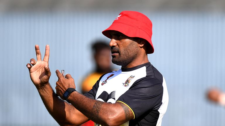 Kumuls coach Michael Marum talks tactics with his players ahead of Sunday's clash with England