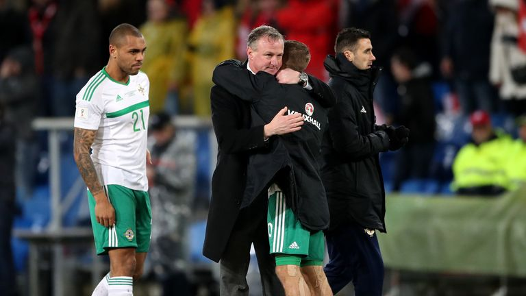 Northern Ireland manager Michael O'Neill embraces Jamie Ward after the second-leg defeat