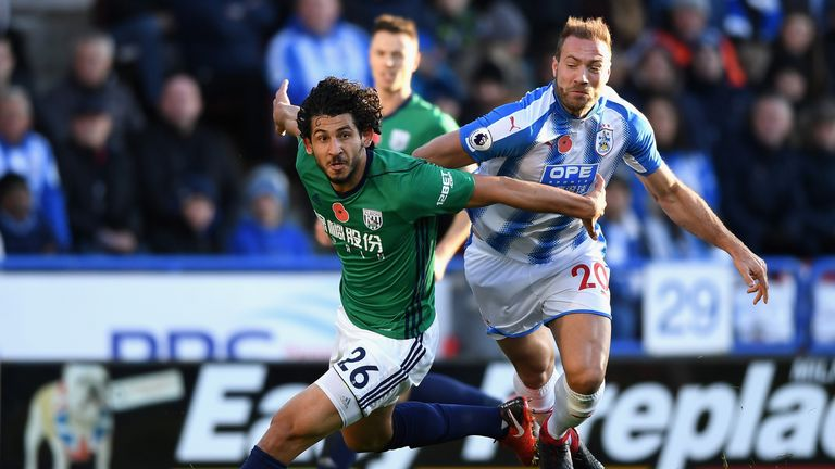 Ahmed El-Sayed Hegazi (left) and Laurent Depoitre compete for the ball