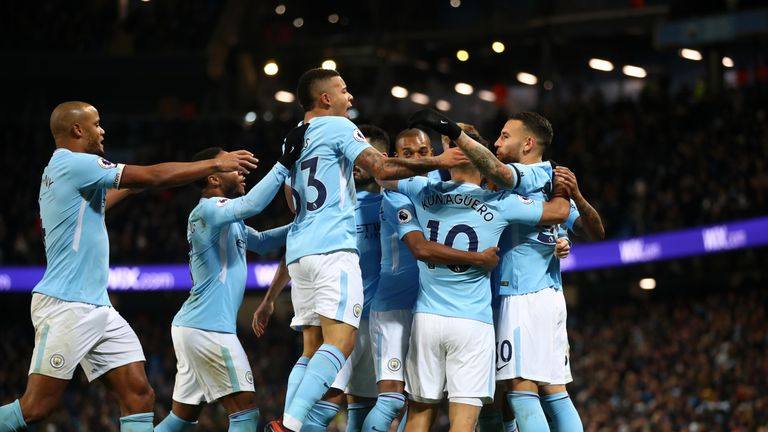 Manchester City players celebrate after taking the lead
