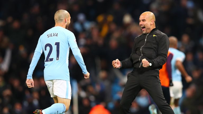 Pep Guardiola and David Silva (left) after City's last-gasp victory against Southampton
