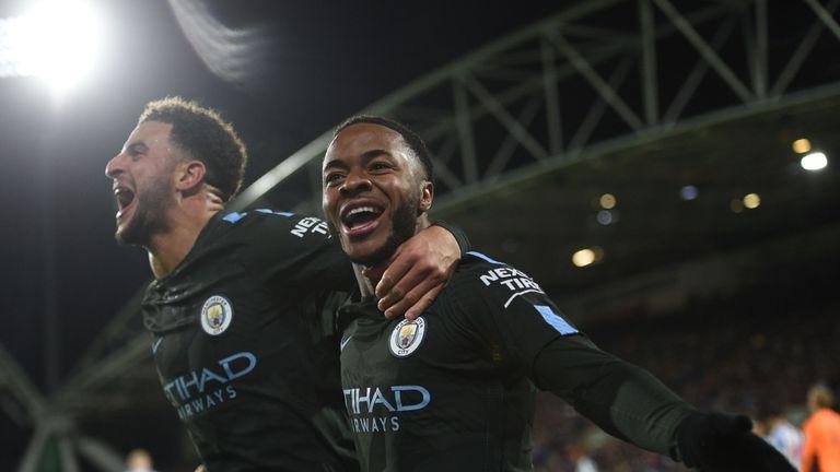 Raheem Sterling celebrates with Kyle Walker (L) after scoring against Huddersfield