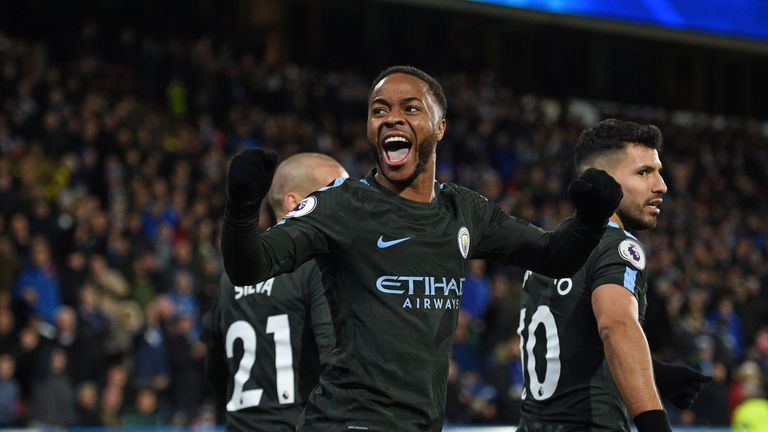 Raheem Sterling celebrates after scoring the winner against Huddersfield on Sunday
