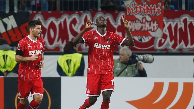 Cologne's Sehrou Guirassy celebrates scoring from the spot against Arsenal