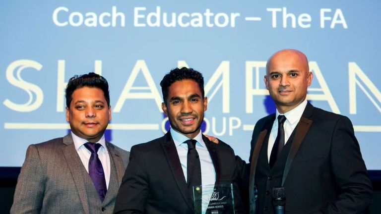 Taff Rahman (c) is presented with the coach award  by Sky Sports News reporter and event co-host Dharmesh Sheth (pic: Punjab 2000)