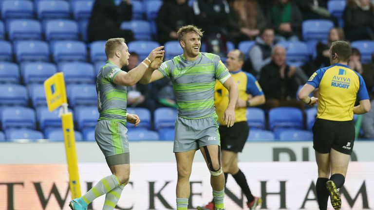 Alex Tait of Newcastle celebrates scoring a try against London Irish