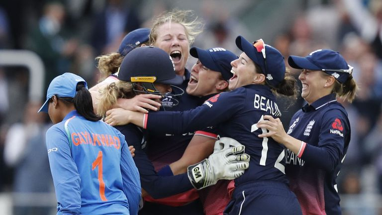 Anya Shrubsole is mobbed by her team-mates after bowling England to World Cup victory at Lord's