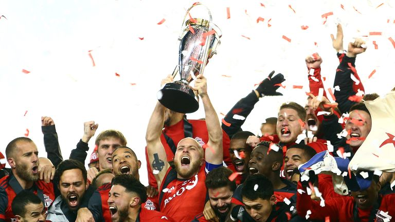Toronto FC's Michael Bradley lifts the Championship Trophy