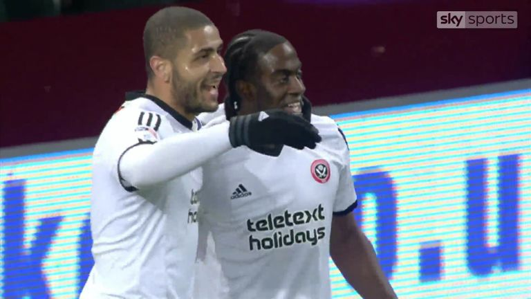 Clayton Donaldson celebrates with team-mate Leon Clarke after scoring Sheffield United's equaliser