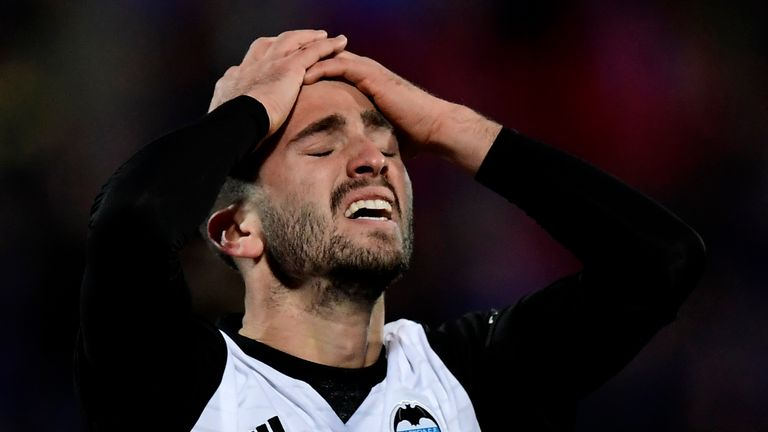 Valencia's Spanish defender Jose Luis Gaya Pena reacts after missing a goal opportunity during the Spanish league football match Getafe CF vs Valencia CF a