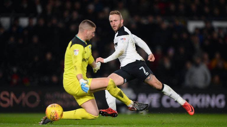 Johnny Russell doubled Derby's lead in the closing minutes of the second-half