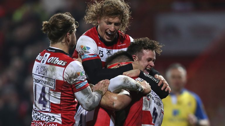 Jake Polledri is mobbed by his Gloucester team-mates after scoring a try against London Irish
