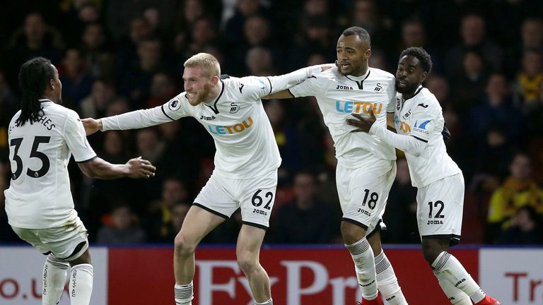 Jordan Ayew (second right) celebrates after equalising late in the game at Vicarage Road