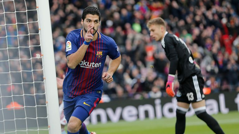 Luis Suarez celebrates scoring just his sixth goal in La Liga this season but Barcelona were pegged back at the Nou Camp